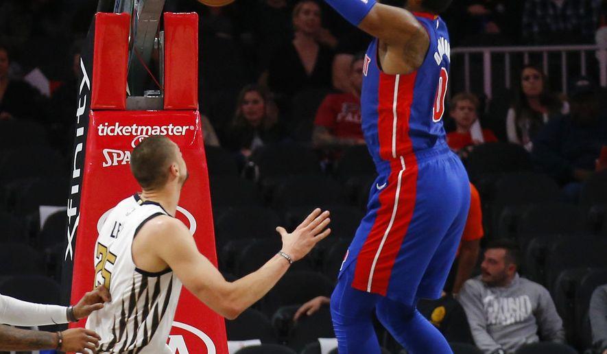 Detroit Pistons center Andre Drummond (0) dunks during the first half of the team's NBA basketball game against the Atlanta Hawks on Friday, Nov. 9, 2018, in Atlanta. (AP Photo/Todd Kirkland)