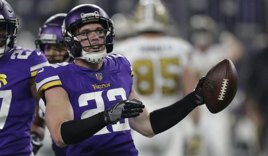 FILE - In this Oct. 28, 2018, file photo, Minnesota Vikings safety Harrison Smith (22) celebrates with teammates after intercepting a pass against the New Orleans Saints during an NFL football game in Minneapolis. Smith has been making his mark for years with big hits and clutch interceptions for the Minnesota Vikings.  As a key piece of one of the NFL's top defenses, the playmaking safety was voted the top player in the league at his position this week by a panel of 10 football writers for The Associated Press. (AP Photo/Andy Clayton-King, File)
