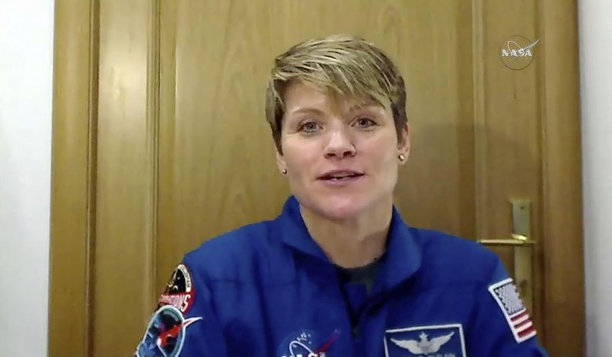 In this image from video made available by NASA, U.S. astronaut Anne McClain speaks during an interview in Star City, Russia on Friday, Nov. 9, 2018. She is set to blast off Dec. 3 on her first spaceflight, with a Russian and Canadian. (NASA via AP)