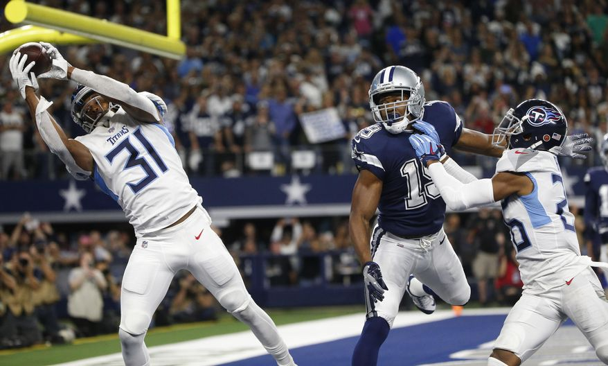 FILE - In this Monday, Nov. 5, 2018, file photo, Tennessee Titans free safety Kevin Byard (31) intercepts a pass intended for Dallas Cowboys wide receiver Amari Cooper (19) during the first half of an NFL football game in Arlington, Texas. The NFL fined Byard $10,026 for his dance celebration on the Cowboys star logo following an end zone interception in Monday's game. But Byard said Friday the fine was actually worth it to him, because it helped to change momentum, denying the Cowboys a possible touchdown in what eventually was a 28-14 Titans victory.(AP Photo/Michael Ainsworth, File)
