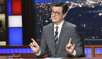 "This Nov. 6, 2018 photo released by CBS shows host Stephen Colbert on the set of ""The Late Show with Stephen Colbert"" in New York. (Scott Kowalchyk/CBS via AP)"