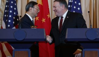 Secretary of State Mike Pompeo, right, shakes hands with Chinese Politburo Member Yang Jiechi at the conclusion of a news conference at the State Department in Washington, Friday, Nov. 9, 2018. (AP Photo/Carolyn Kaster)