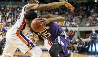 Washington forward Noah Dickerson (15) challenges Auburn center Austin Wiley (50) during the first half of an NCAA college basketball game, Friday, Nov. 9, 2018, in Auburn, Ala. (AP Photo/Vasha Hunt)
