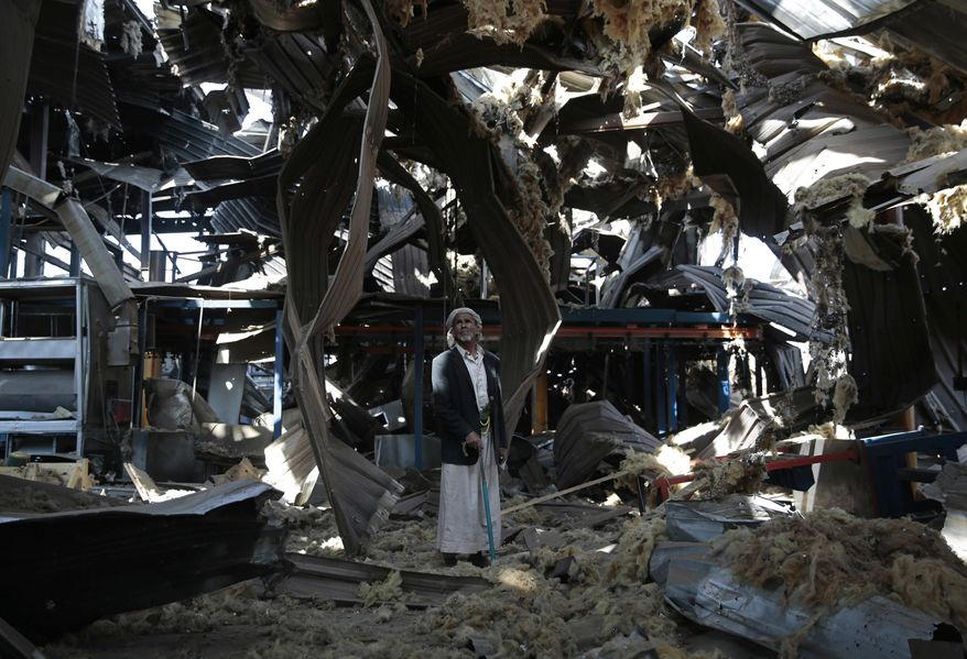 """FILE - In this Sept. 22, 2016, file photo, a man stands among the rubble of the Alsonidar Group's water pump and pipe factory after it was hit by Saudi-led airstrikes in Sanaa, Yemen. The Saudi-led coalition fighting in Yemen said early Saturday, Nov. 10, 2018, it had """"requested cessation of inflight refueling"""" by the U.S. for its fighter jets after American officials said they would stop the operations amid growing anger over civilian casualties from the kingdom's airstrikes. (AP Photo/Hani Mohammed, File)"""