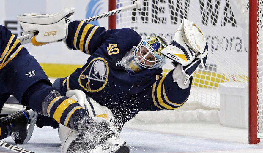 Buffalo Sabres goalie Carter Hutton (40) sprawls to make a glove save during the second period of an NHL hockey game against the Vancouver Canucks, Saturday, Nov. 10, 2018, in Buffalo N.Y. (AP Photo/Jeffrey T. Barnes)