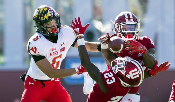 Indiana defensive back Jaylin Williams (23) and defensive back Marcelino Ball (42) battle to grab a pass intended for Maryland wide receiver Jeshaun Jones (6) during the first half of an NCAA college football game Saturday, Nov. 10, 2018, in Bloomington, Ind. (AP Photo/Doug McSchooler) ** FILE **