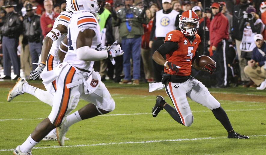 Georgia wide receiver Terry Godwin gets past Auburn defenders for a 37-yard touchdown catch against Auburn during the second quarter of an NCAA college football game on Saturday, Nov. 10, 2018, in Athens, Ga. (Curtis Compton/Atlanta Journal-Constitution via AP)