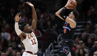 Chicago Bulls guard Zach LaVine, right, shoots against Cleveland Cavaliers guard David Nwaba during the first half of an NBA basketball game Saturday, Nov. 10, 2018, in Chicago. The Bulls won 99-98. (AP Photo/Nam Y. Huh)