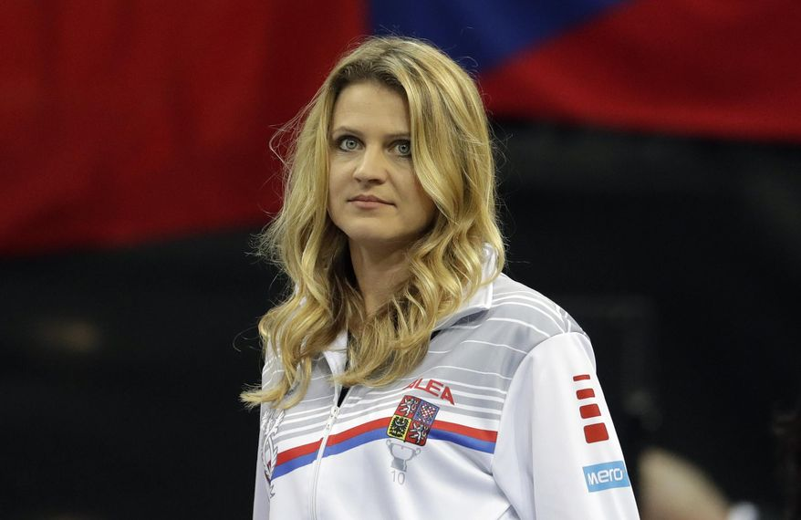 Tennis player Lucie Safarova of the Czech Republic watches a tennis match of the Fed Cup Final between Czech Republic and United States in Prague, Czech Republic, Saturday, Nov. 10, 2018. Former French Open finalist Lucie Safarova said on Saturday that she is planning to retire after the Australian Open. (AP Photo/Petr David Josek)