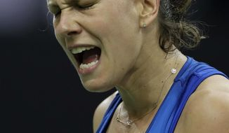 Barbora Strycova of the Czech Republic reacts after scoring a point against Sofia Kenin of the United States during their tennis match of the Fed Cup Final between Czech Republic and United States in Prague, Czech Republic, Saturday, Nov. 10, 2018. (AP Photo/Petr David Josek)