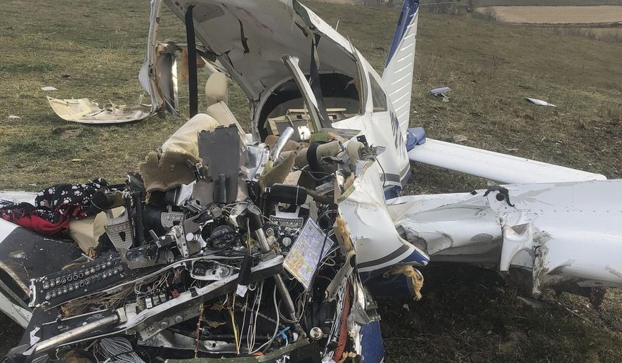 This Saturday, Nov. 10, 2018 photo provided by Guthrie County Sheriff's Department in Iowa shows the scene where a small plane crashed in central Iowa, killing all four people on board, including a teenage girl. Guthrie County Sheriff's Deputy Jesse Swensen says the plane was reported missing shortly after it took off Friday, Nov. 9,  from the Le Mars Municipal Airport in northwestern Iowa. He says the wreckage was found at around 6:30 a.m. Saturday in a cattle pasture southwest of Guthrie Center,  (Guthrie County Sheriff's Department via AP)