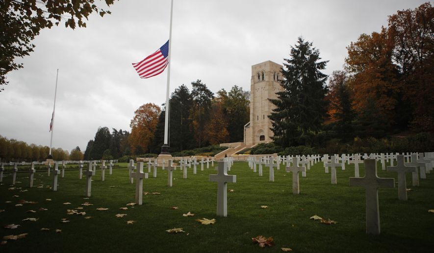 The US flag flutters at half mast prior to a ceremony at the Aisne-Marne American cemetery and memorial in Belleau, eastern France, Saturday, Nov. 10, 2018. President Donald Trump cancelled his visit due to bad weather. More than 60 heads of state and government are converging on France for the commemorations that will crescendo Sunday with ceremonies at the Tomb of the Unknown Soldier in Paris on the 11th hour of the 11th day of the 11th month, exactly a century after the armistice. (AP Photo/Francois Mori)
