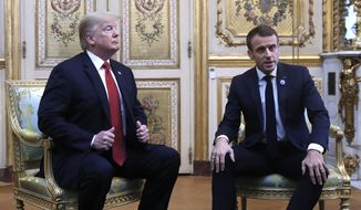 President Donald Trump meets with French President Emmanuel Macron inside the Elysee Palace in Paris Saturday Nov. 10, 2018. Trump is joining other world leaders at centennial commemorations in Paris this weekend to mark the end of World War I. (AP Photo/Jacquelyn Martin)