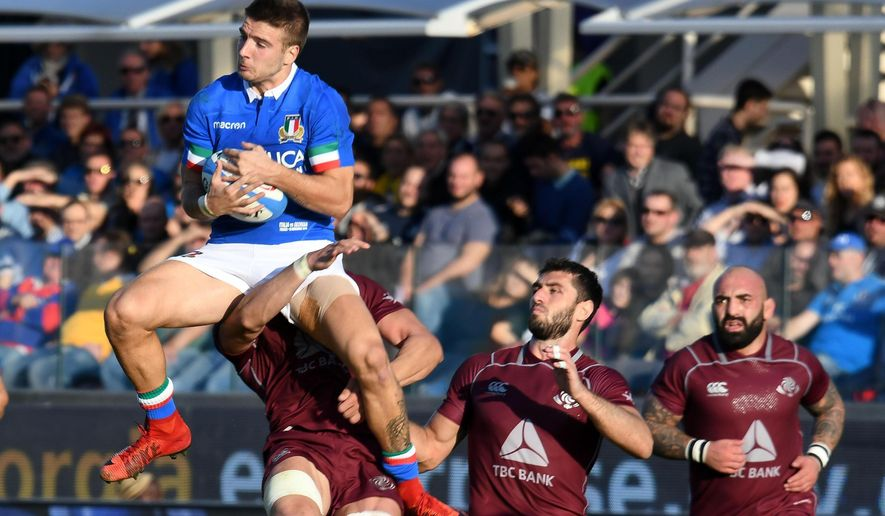 Italy's Luca Sperandio, left, jumps for the ball during an international test match between Italy and Georgia, at the Artemio Franchi stadium in Florence, Italy, Saturday, Nov. 10, 2018. (Claudio Giovanni/ANSA via AP)