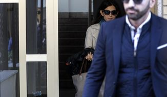 Rome mayor Virginia Raggi leaves her house, in Rome, Saturday, Nov. 10, 2018. A verdict is expected within hours for Rome's mayor, on trial in the Italian capital for allegedly lying about a City Hall hire.(Riccardo Antimiani/ANSA via AP)
