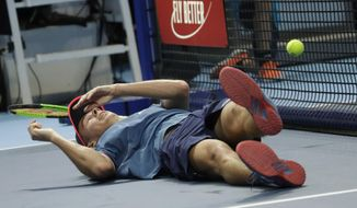Alex De Minaur, of Australia, falls as he plays against Stefanos Tsitsipas of Greece, during the ATP Next Gen tennis tournament final, at the Rho fair, near Milan, Italy, Saturday, Nov. 10, 2018. (AP Photo/Luca Bruno)