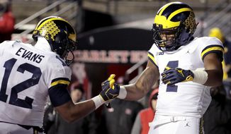 Michigan wide receiver Nico Collins, right, celebrates his touchdown catch with running back Chris Evans during the second half of an NCAA college football game against Rutgers, Saturday, Nov. 10, 2018, in Piscataway, N.J. (AP Photo/Julio Cortez)