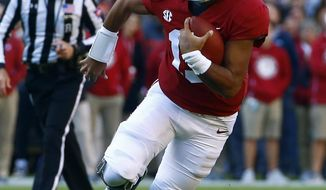 Alabama quarterback Tua Tagovailoa (13) scrambles for yardage during the first half of an NCAA college football game against Mississippi State, Saturday, Nov. 10, 2018, in Tuscaloosa, Ala. (AP Photo/Butch Dill)