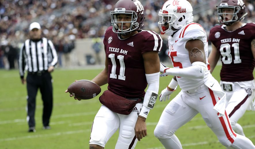 Texas A&M quarterback Kellen Mond (11) rushes for a touchdown as Mississippi Rebels defensive back Myles Hartsfield (15) defends during the first half of an NCAA college football game Saturday, Nov. 10, 2018, in College Station, Texas. (AP Photo/David J. Phillip)