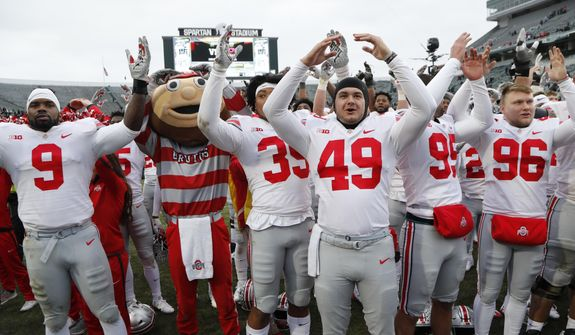 """Ohio State players sing """"Carmen Ohio"""" after their NCAA college football game against the Michigan State, Saturday, Nov. 10, 2018, in East Lansing, Mich. (AP Photo/Carlos Osorio) ** FILE **"""