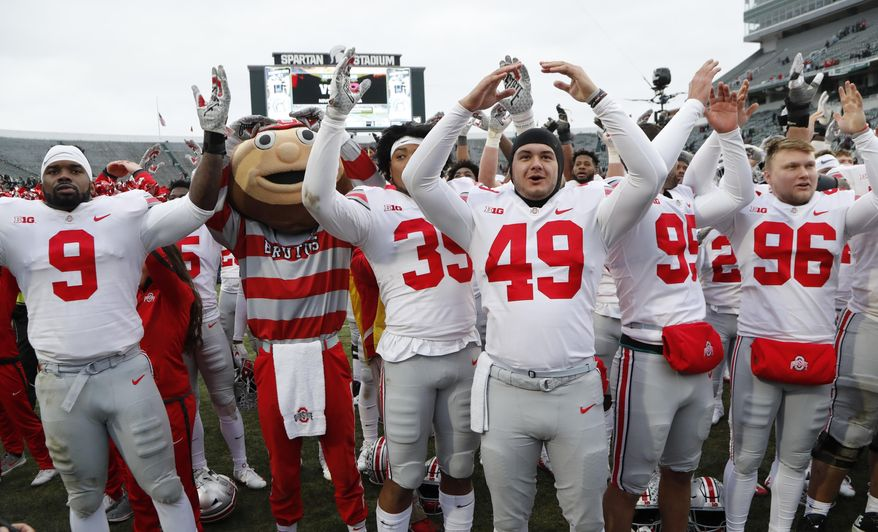 "Ohio State players sing ""Carmen Ohio"" after their NCAA college football game against the Michigan State, Saturday, Nov. 10, 2018, in East Lansing, Mich. (AP Photo/Carlos Osorio) ** FILE **"
