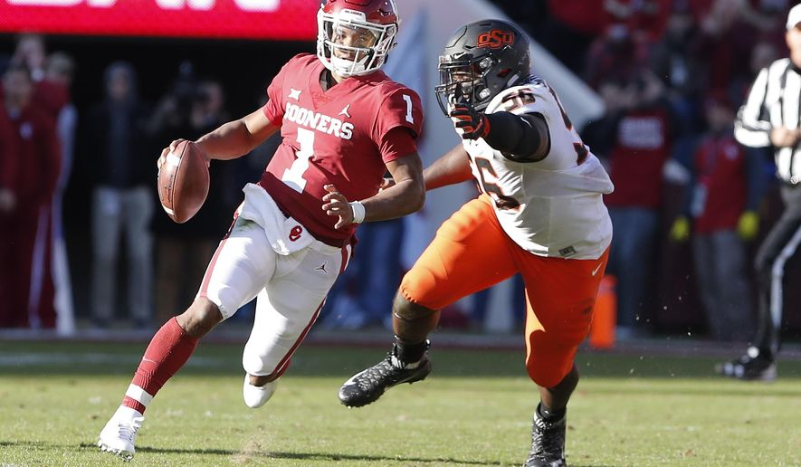 Oklahoma quarterback Kyler Murray (1) scrambles for a first down ahead of Oklahoma State defensive tackle Enoch Smith Jr. (56) in the second quarter of an NCAA college football game in Norman, Okla., Saturday, Nov. 10, 2018. (AP Photo/Alonzo Adams)