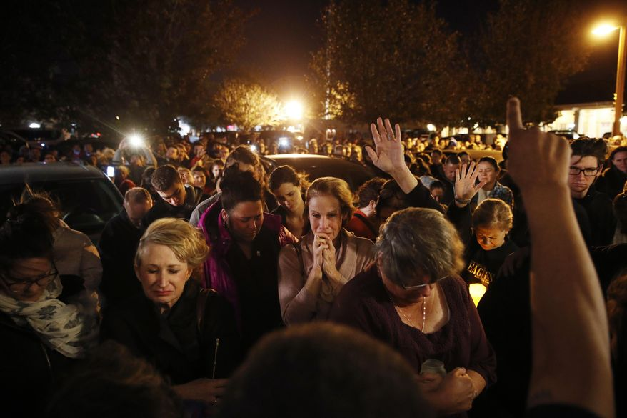 People gather outside a coffee shop for a vigil for Sean Adler Thursday, Nov. 8, 2018, in Simi Valley, Calif. Adler was killed in Wednesday night's mass shooting at the Borderline Bar and Grill in Thousand Oaks, Calif. (AP Photo/Jae C. Hong)
