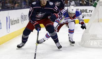 Columbus Blue Jackets forward Pierre-Luc Dubois, left, chases the puck against New York Rangers forward Jimmy Vesey during the first period of an NHL hockey game in Columbus, Ohio, Saturday, Nov. 10, 2018. (AP Photo/Paul Vernon)