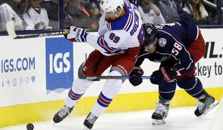 New York Rangers forward Pavel Buchnevich, left, of Russia, works against Columbus Blue Jackets defenseman David Savard during the first period of an NHL hockey game in Columbus, Ohio, Saturday, Nov. 10, 2018. (AP Photo/Paul Vernon)