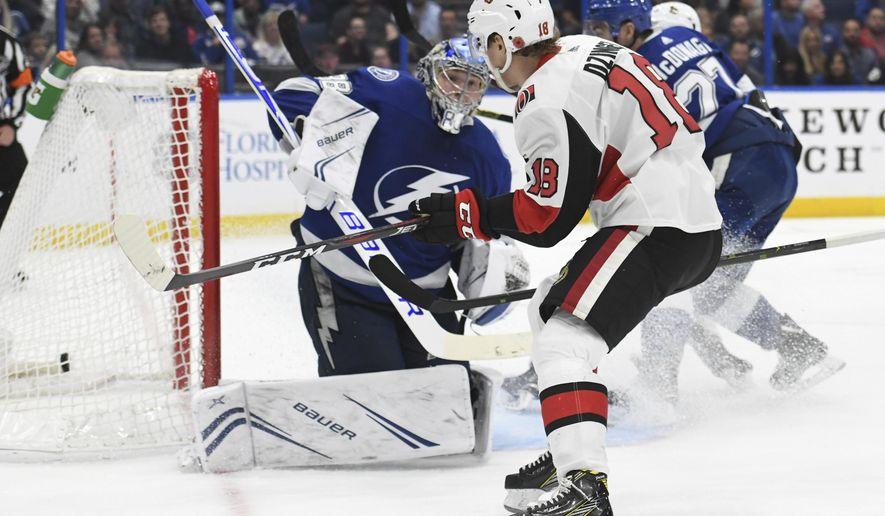 Ottawa Senators left wing Ryan Dzingel (18) scores past Tampa Bay Lightning goaltender Andrei Vasilevskiy (88) during the third period of an NHL hockey game Saturday, Nov. 10, 2018, in Tampa, Fla. (AP Photo/Jason Behnken)