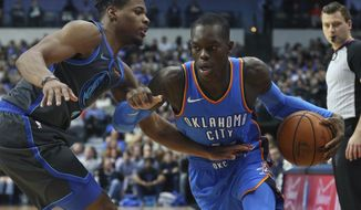 Dallas Mavericks guard Dennis Smith Jr. (1) defends against the drive by Oklahoma City Thunder guard Dennis Schroder (17) in the first half of an NBA basketball game Saturday, Nov. 10, 2018, in Dallas. (AP Photo/Richard W. Rodriguez)