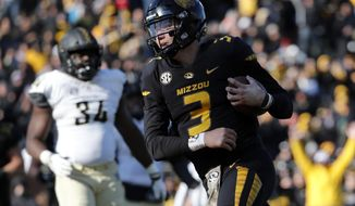 Missouri quarterback Drew Lock scores on a 3-yard touchdown run during the second half of an NCAA college football game against Vanderbilt Saturday, Nov. 10, 2018, in Columbia, Mo. Missouri won 33-28. (AP Photo/Jeff Roberson)