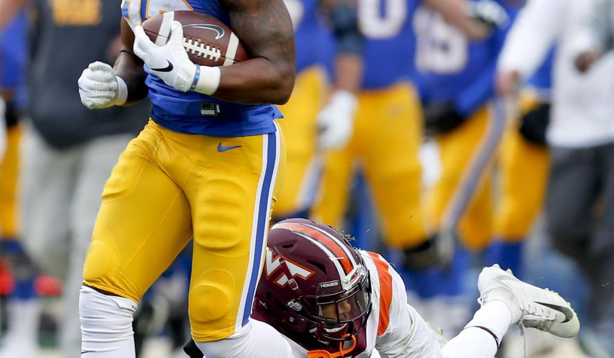 Pittsburgh running back Darrin Hall (22) breaks away from Virginia Tech defensive back Tyree Rodgers (18) for a run over fifty yard in the first quarter of an NCAA football game, Saturday, Nov. 10, 2018, in Pittsburgh. (AP Photo/Keith Srakocic)