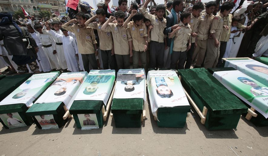 FILE - In this Aug. 13, 2018 file photo, Yemenis attend the funeral of victims of a Saudi-led airstrike, in Saada, Yemen. Airstrikes by Saudi Arabia and its allies in Yemen are on a pace to kill more civilians in 2018 than last year despite US claims that the coalition is working to prevent such bloodshed, a database tracking violence shows. The war, nearly four years old, may have killed as many as 80,000 people, according to the figures, not counting the untold numbers who have died of hunger in the humanitarian disaster wreaked by the conflict. (AP Photo/Hani Mohammed, File)