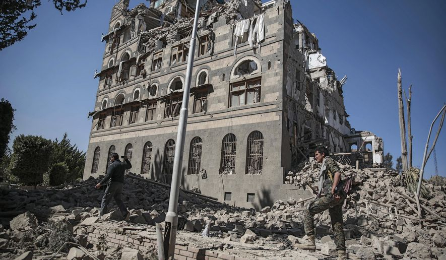 FILE - In this Dec. 6, 2017 file photo, Houthi Shiite rebels inspect the rubble of the Republican Palace that was destroyed by Saudi-led airstrikes, in Sanaa, Yemen. Airstrikes by Saudi Arabia and its allies in Yemen are on a pace to kill more civilians in 2018 than last year despite US claims that the coalition is working to prevent such bloodshed, a database tracking violence shows. The war, nearly four years old, may have killed as many as 80,000 people, according to the figures. (AP Photo/Hani Mohammed, File)