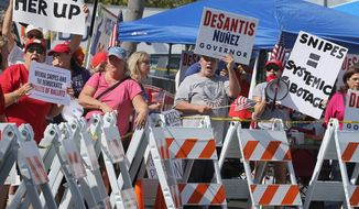 Protesters gathered outside the Broward County of Supervisor of Elections Office on Sunday as Florida's election recount continued. Ballots for governor, Senate and the Agricultural Commission were run through scanning machines for a second time. (Associated Press)