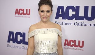 Alyssa Milano arrives at the ACLU SoCal's Bill of Rights Dinner at the Beverly Wilshire Hotel on Sunday, Nov. 11, 2018, in Beverly Hills, Calif. (Photo by Richard Shotwell/Invision/AP)