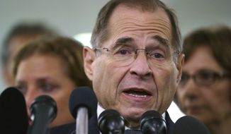 House Judiciary Committee ranking member Jerry Nadler, D-N.Y., talks to media during a Senate Judiciary Committee hearing on Capitol Hill in Washington, Friday, Sept. 28, 2018. After a flurry of last-minute negotiations, the Senate Judiciary Committee advanced Brett Kavanaugh's nomination for the Supreme Court after agreeing to a late call from Sen. Jeff Flake, for a one week investigation into sexual assault allegation against the high court nominee. (AP Photo/Carolyn Kaster)