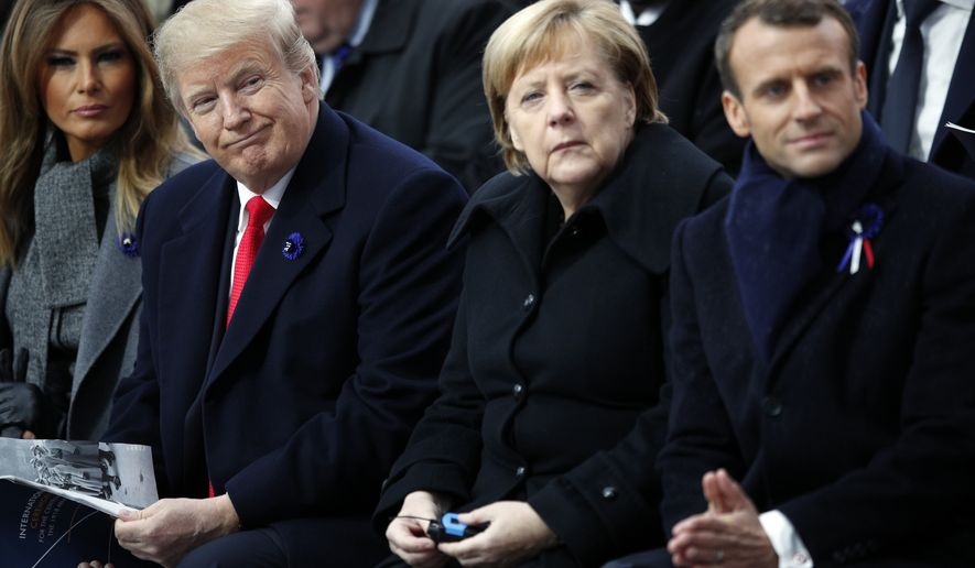 U.S President Donald Trump, German Chancellor Angela Merkel and French President Emmanuel Macron attend ceremonies at the Arc de Triomphe Sunday, Nov. 11, 2018 in Paris. (AP Photo/Francois Mori, Pool)