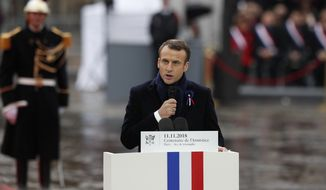 French President Emmanuel Macron delivers his speech during ceremonies at the Arc de Triomphe Sunday, Nov. 11, 2018 in Paris. Over 60 heads of state and government were taking part in a solemn ceremony at the Tomb of the Unknown Soldier, the mute and powerful symbol of sacrifice to the millions who died from 1914-18. (AP Photo/Francois Mori, Pool)