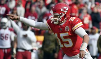 Kansas City Chiefs quarterback Patrick Mahomes (15) reacts to his touchdown pass to wide receiver Tyreek Hill (10), during the first half of an NFL football game against the Arizona Cardinals in Kansas City, Mo., Sunday, Nov. 11, 2018. (AP Photo/Ed Zurga)