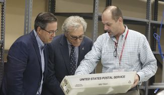 Broward Supervisor of Elections Joe D'Alesandro, right, shows voting materials to campaign representatives, Sunday, Nov. 11, 2018, at the Broward Supervisor of Elections office in Lauderhill, Fla. (Joe Cavaretta /South Florida Sun-Sentinel via AP) **FILE**