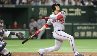 MLB All-Star Juan Soto of the Washington Nationals watches the flight of his fly ball in the fourth inning of Game 3 against All Japan at the All-Stars Series baseball at Tokyo Dome in Tokyo, Sunday, Nov. 11, 2018. The fly ball hit the ceiling of the dome and was caught. Soto was a ground-rule fly out to right. (AP Photo/Toru Takahashi) ** FILE **