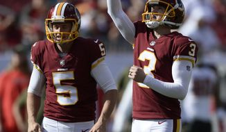 Washington Redskins kicker Dustin Hopkins (3) celebrates his field goal against the Tampa Bay Buccaneers as holder Tress Way (5) looks on during the first half of an NFL football game Sunday, Nov. 11, 2018, in Tampa, Fla. (AP Photo/Jason Behnken)