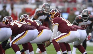 Washington Redskins quarterback Alex Smith (11) lines up against the Tampa Bay Buccaneers during the first half of an NFL football game Sunday, Nov. 11, 2018, in Tampa, Fla. (AP Photo/Jason Behnken)