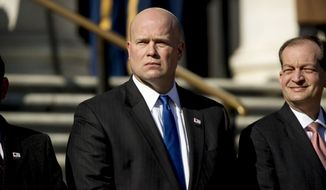 Acting United States Attorney General Matt Whitaker, center, and Labor Secretary Alex Acosta, right, attend a wreath laying ceremony at the Tomb of the Unknown Soldier during a ceremony at Arlington National Cemetery on Veterans Day, Sunday, Nov. 11, 2018 in Arlington, Va. (AP Photo/Andrew Harnik)