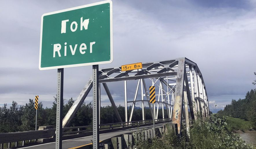 This undated photo provided by the Alaska Department of Transportation and Public Facilities shows a World War II-era, truss-style bridge at Mile 1309 of the Alaska Highway near Tok, Alaska. The bridge has been replaced by a temporary detour bridge and a permanent replacement is scheduled to be in place by October 2019. (Alaska Department of Transportation and Public Facilities via AP)