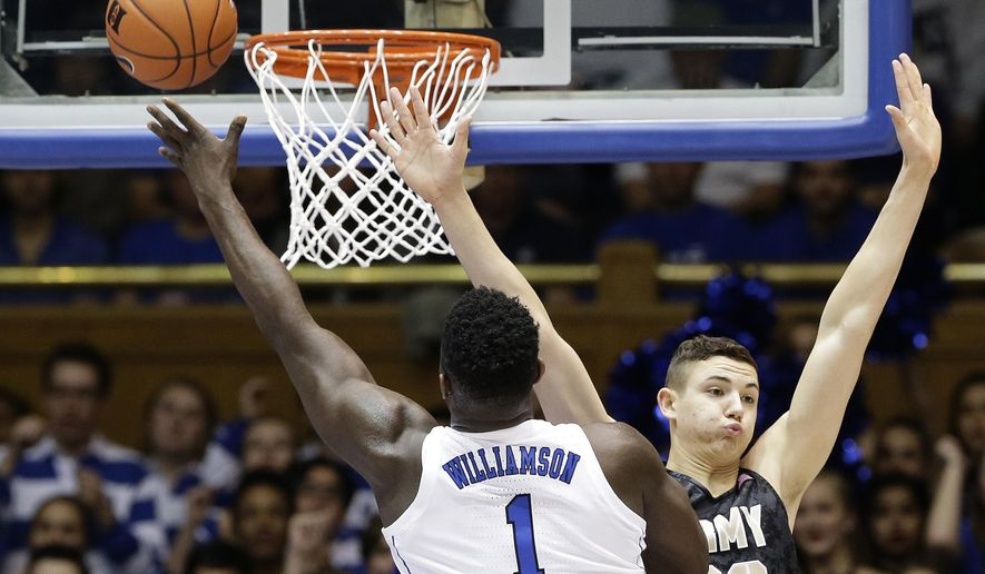 Duke's Zion Williamson (1) drives to the basket as Army's Ben Kinker (30) defends during the first half of an NCAA college basketball game in Durham, N.C., Sunday, Nov. 11, 2018. (AP Photo/Gerry Broome)