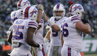Buffalo Bills quarterback Matt Barkley (5) celebrates with teammates after the Bills scored a touchdown against the New York Jets during the third quarter of an NFL football game, Sunday, Nov. 11, 2018, in East Rutherford, N.J. (AP Photo/Seth Wenig)