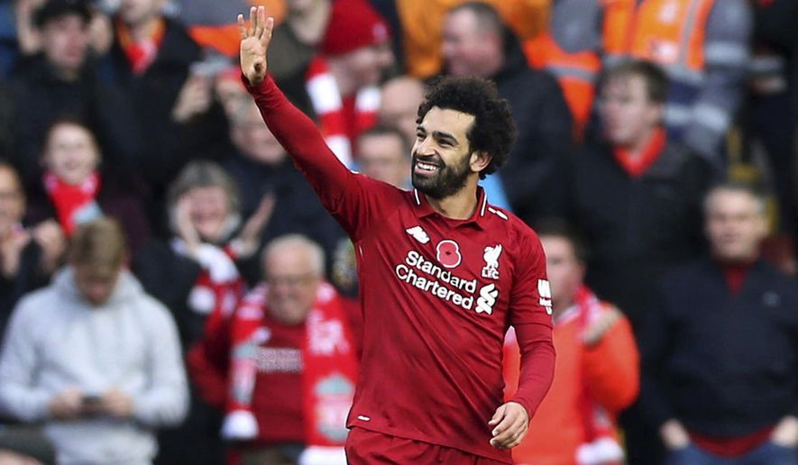 Liverpool's Mohamed Salah celebrates scoring his side's first goal of the game during the English Premier League soccer match between Liverpool and Fulham, at Anfield Stadium, in Liverpool, England, Sunday, Nov. 11, 2018. (Barrington Coombs/PA via AP)